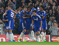 Willian of Chelsea celebrates scoring the first goal with teammates during the UEFA Champions League match between Chelsea and Maccabi Tel Aviv at Stamford Bridge, London, England on 16 September 2015. Photo by Andy Rowland.