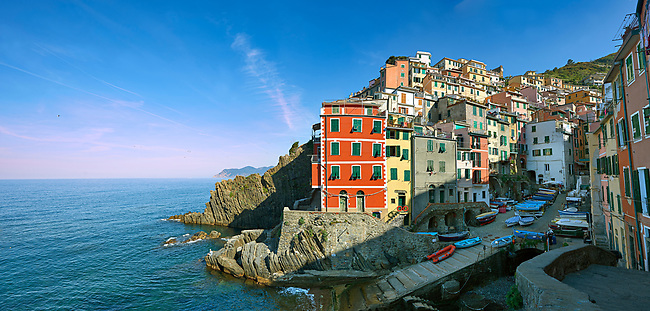 Fishing village and harbour of Riomaggiore at sunrise, Cinque Terre National Park, Liguria, Italy