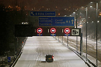 WEATHER PICTURE WALES<br /> Pictured: A car travels on the almost deserted M4 motorway in the early hours of the morning, near Newport because of the snow in south Wales, UK.<br /> Re: Snow caused by the Beast from the East hits parts of the UK.
