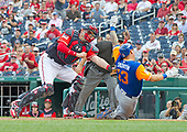 Washington Nationals catcher Matt Wieters (32) tags out New York Mets third baseman Asdrubal Cabrera (13) as he attempts to score in the first inning against the Washington Nationals at Nationals Park in Washington, D.C. on Saturday, August 26, 2017.<br /> Credit: Ron Sachs / CNP<br /> (RESTRICTION: NO New York or New Jersey Newspapers or newspapers within a 75 mile radius of New York City)