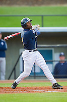 Ray Crawford (1) of the UNCG Spartans follows through on his swing against the Georgia Southern Eagles at UNCG Baseball Stadium on March 29, 2013 in Greensboro, North Carolina.  The Spartans defeated the Eagles 5-4.  (Brian Westerholt/Four Seam Images)
