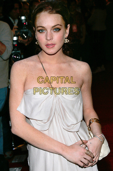 LINDSAY LOHAN.The 2006 Conde Nast Traveler Hot List Party at Buddah Bar, New York, NY, USA..April 18th, 2006.Photo: Jackson Lee/Admedia/Capital Pictures.Ref: JL/ADM.half length white strapless ring braccelet.www.capitalpictures.com.sales@capitalpictures.com.© Capital Pictures.