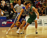 Hugh Quinlivan looks to get by Piers Finch during the NBL Round 14 match between the Manawatu Jets  and Wellington Saints. Arena Manawatu, Palmerston North, New Zealand on Saturday 31 May 2008. Photo: Dave Lintott / lintottphoto.co.nz
