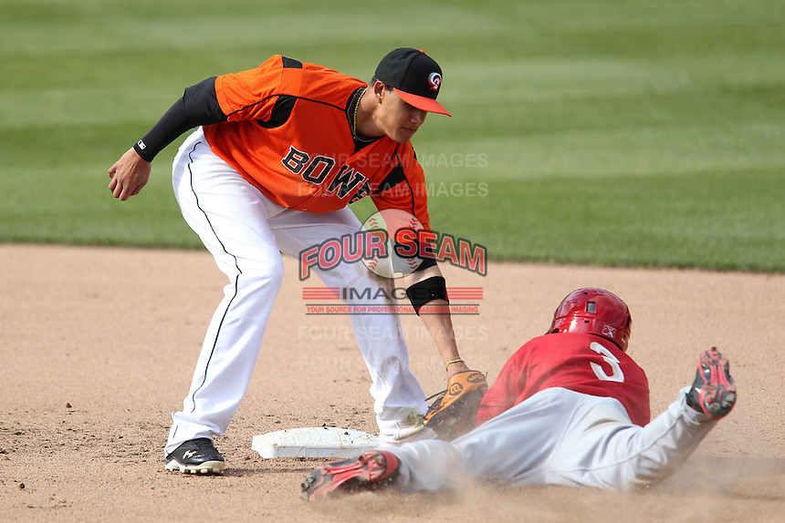 Bowie BaySox shortstop Manny Machado #3 tags out Eury Perez #3 on a steal attempt during a game against the Harrisburg Senators at Prince George's Stadium on April 8, 2012 in Bowie, Maryland.  Harrisburg defeated Bowie 5-2.  (Mike Janes/Four Seam Images)