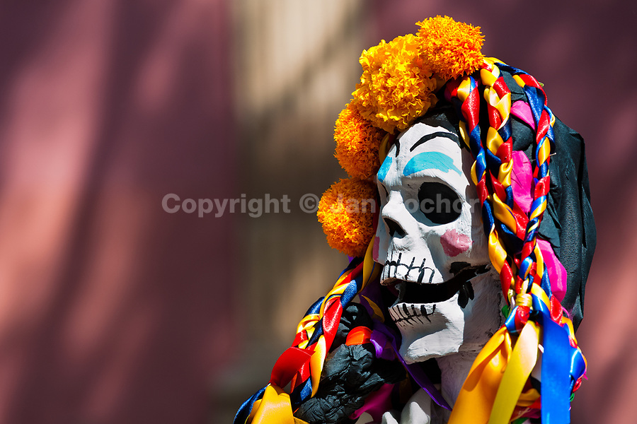 A decorated skeleton figurine is seen at the altar of the dead (altar de muertos), a religious site honoring the deceased, during the Day of the Dead celebration in Morelia, Michoacán, Mexico, 3 November 2014. Day of the Dead ('Día de Muertos') is a syncretic religious holiday, celebrated throughout Mexico, combining the death veneration rituals of the ancient Aztec culture with the Catholic practice. Based on the belief that the souls of the departed may come back to this world on that day, people gather on the gravesites praying, drinking and playing music, to joyfully remember friends or family members who have died and to support their souls on the spiritual journey.