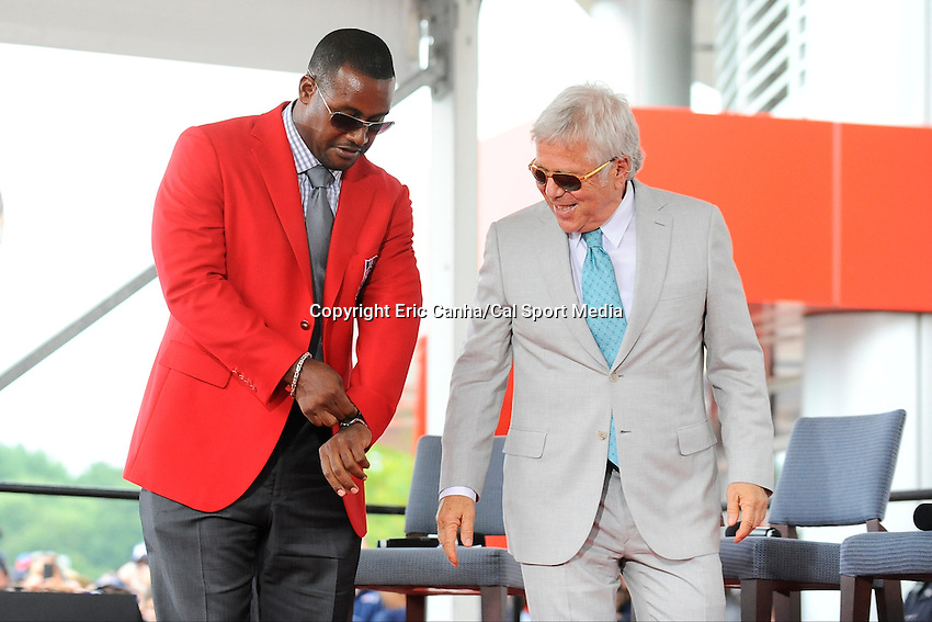 August 1, 2014 - Foxborough, Massachusetts, U.S.- Ty Law puts on his red Hall of Fame jacket presented by Patriots owner Robert Kraft during the New England Patriots Hall of Fame induction ceremony held at  The Hall at Patriot Place in Foxborough Massachusetts.  Eric Canha/CSM