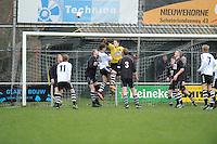 VOETBAL: MILDAM: 04-04-2015, VV Mildam - VV Oldeboarn, uitslag 1-4, Doelman Dennis Faber van Oldeboorn werk de bal uit het doelgebied (#1), ©foto Martin de Jong