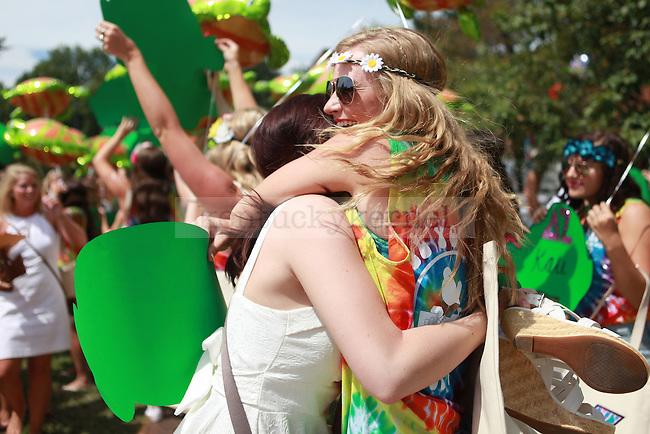 Members of Delta Zeta embrace at sorority bid day in Lexington, Ky., on Friday, August 21,  2015. Photo by Emily Wuetcher | Staff