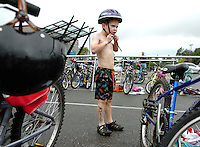 Zachary Duprey-Steinman, 6, of New Westminster, center, tightens his helmet as he transitions from the swimming portion to the cycling leg of the 2008 Bellingham Youth Triathlon on Saturday, August 9, 2008.  For six, seven and eight-year-old competitors, the race included a 100 yard swim in the Arne Hanna Aquatic Center pool, then a one-mile bicycle ride and a 1/4 mile run through the surrounding area.