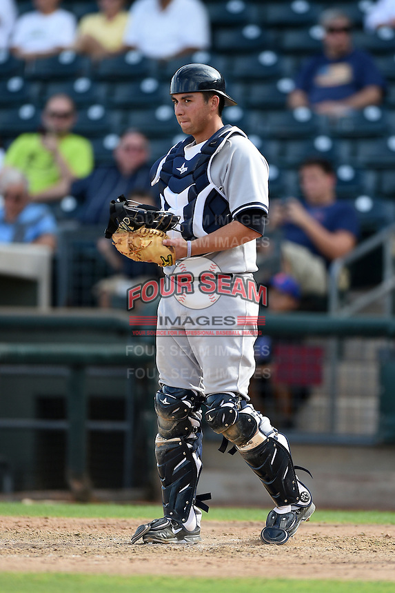 Scottsdale Scorpions catcher Kyle Higashioka (58) during an Arizona Fall League game against the Peoria Javelinas on October 18, 2014 at Surprise Stadium in Surprise, Arizona.  Peoria defeated Scottsdale 4-3.  (Mike Janes/Four Seam Images)
