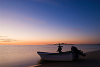 Fishing boat sits on shore of Sea of Cortez at dawn, San Felipe, Baja California, Mexico