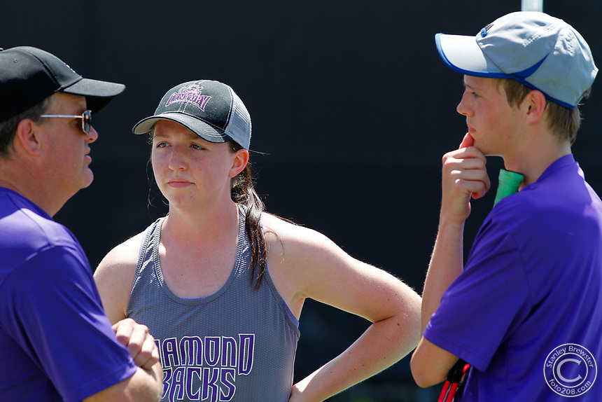 Century mixed doubles team of Sutton and Klutsch talk to their coach during during the State 4A Mixed Doubles championships.