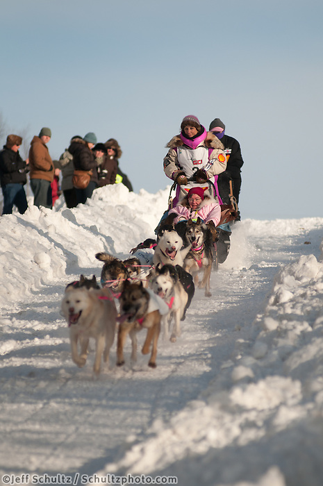 Musher DeeDee Jonrowe and Iditarider Beverley Nelms on Cordova street hill in downtown Anchorage, Alaska  during the ceremonial start of the 2011 Iditarod Trail Sled Dog Race