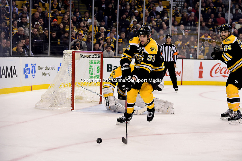Thursday, December 15, 2016: Boston Bruins defenseman Zdeno Chara (33) reaches for a rebounding puck during the National Hockey League game between the Anaheim Ducks and the Boston Bruins held at TD Garden, in Boston, Mass. The Ducks beat the Bruins 4-3 in regulation time. Eric Canha/CSM