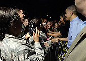 United States President Barack Obama and first lady Michelle Obama greet military personnel at Joint Base Pearl Harbor-Hickam in Honolulu, Hawaii as they arrive for the First Family's winter vacation in Hawaii on December 20, 2013.<br /> Credit: Cory Lum / Pool via CNP
