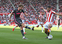 Leeds United's Patrick Bamford crosses the ball for team-mate Ezgjan Alioski to score their sides second goal despite the attentions of Stoke City's Cameron Carter-Vickers<br /> <br /> Photographer Stephen White/CameraSport<br /> <br /> The Premier League - Stoke City v Leeds United - Saturday August 24th 2019 - bet365 Stadium - Stoke-on-Trent<br /> <br /> World Copyright © 2019 CameraSport. All rights reserved. 43 Linden Ave. Countesthorpe. Leicester. England. LE8 5PG - Tel: +44 (0) 116 277 4147 - admin@camerasport.com - www.camerasport.com
