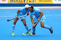 Sardar Singh and Mandeep Singh of india collide during the Hockey World League Quarter-Final match between India and Malaysia at the Olympic Park, London, England on 22 June 2017. Photo by Steve McCarthy.