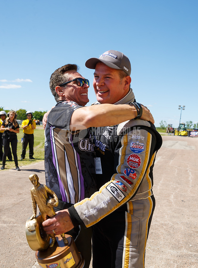 Apr 23, 2017; Baytown, TX, USA; NHRA pro mod drier Steve Matusek celebrates with team owner Danny Rowe after winning the Springnationals at Royal Purple Raceway. Mandatory Credit: Mark J. Rebilas-USA TODAY Sports