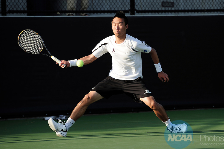 26 MAY 2011: Andrew Jung of Amherst returns a serve during the Division III Men's Tennis Championship held at the Biszantz Family Tennis Center and Pauley Tennis Complex in Claremont, CA. Amherst defeated Emory 5-2 for the national title. Stephen Nowland/NCAA Photos