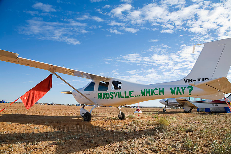 One of the many aircraft parked at the Birdsville aerodrome during the annual Birdsville Races.  Every September hundreds of aircraft arrive at the remote town for the most famous horse racing carnival in outback Australia.  Birdsville, Queensland, AUSTRALIA.