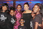 Figure Skating in Harlem celebrates 20 years - Champions in Life benefit Gala on May 2, 2017 as As The World Turns' Tamara Tunie and Candace Matthews pose with the skaters at 583 Park Avenue, New York City, New York. (Photo by Sue Coflin/Max Photos)