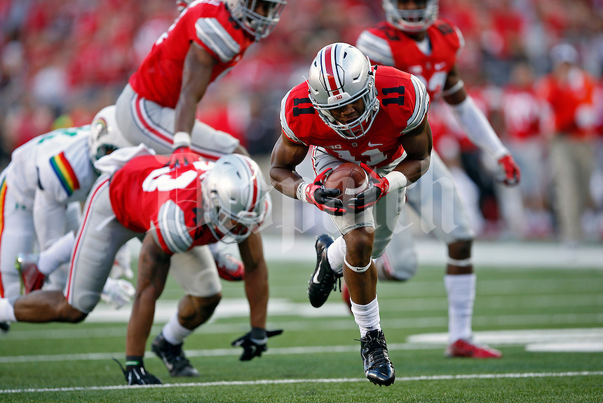 Ohio State Buckeyes safety Vonn Bell (11) picks up the ball during a fumble and scores a touchdown against Hawaii Warriors in the fourth quarter of their game at Ohio Stadium on September 12, 2015.  (Dispatch photo by Kyle Robertson)