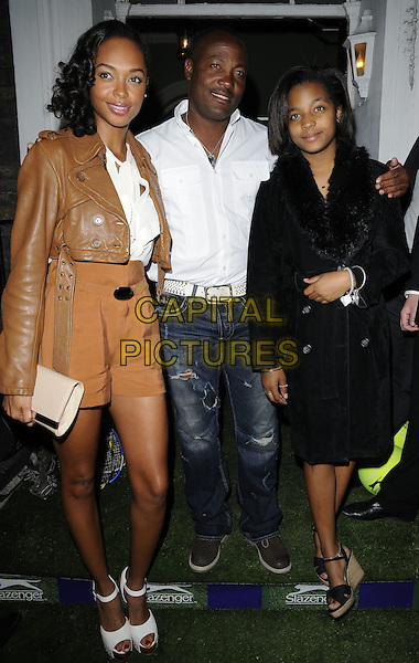 Brian Lara & daughters .At the Slazenger Party, The House of St. Barnabas, Greek Street, London, England, UK, 23rd June 2011..full length beige tan white shirt jeans family kids children dad father shirts brown leather jacket .CAP/CAN.©Can Nguyen/Capital Pictures.