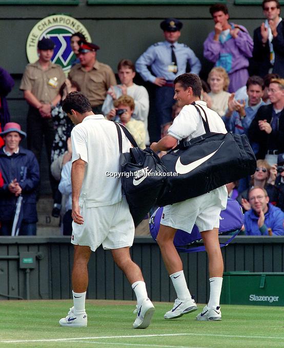 1996, England, Tennis, Wimbledon, Richard Krajicek just defeated Pete Sampras(L) and towers over him