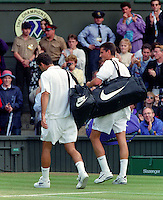 1996, England, Tennis, Wimbledon, Richard Krajicek just defeated Pete Sampras(L) and towers over him