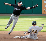 """Reno's shortstop Jake Elmore keeps the throw from the catcher from going into centerfield as Bees runner Doug Deeds steals second. Aces are transformed into the Reno Ghost Riders for the """"What Could Have Been Weekend"""" series against the Salt Lake Bees on Thursday night July 12, 2012 at Aces Ballpark in Reno, NV."""