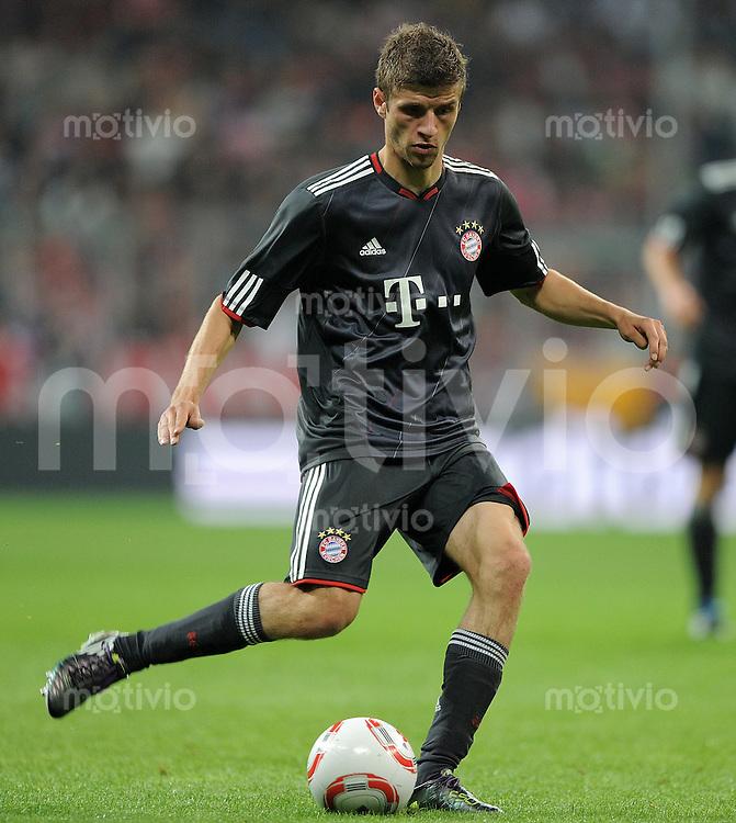 FUSSBALL  INTERNATIONAL   SAISON 2010/2011   13.08.2010 FC Bayern  Muenchen  - CF Real Madrid  Thomas Mueller (FC Bayern Muenchen)