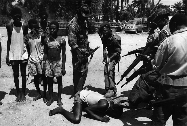 Suspected Lumumbist freedom fighters being tormented before execution, Stanleyville, Congo, 1964