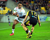 Seta Tamanivalu runs at James Marshall during the Super Rugby semifinal match between the Hurricanes and Chiefs at Westpac Stadium, Wellington, New Zealand on Saturday, 30 July 2016. Photo: Dave Lintott / lintottphoto.co.nz