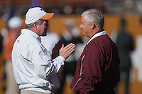 24 November 2006: Texas head coach Mack Brown (left) speaks with Texas A&M head coach Dennis Franchione during warmups before the Longhorns 12-7 loss to the Texas A&M University Aggies at Darrell K Royal Memorial Field in Austin, TX.