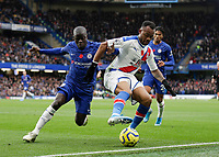 9th November 2019; Stamford Bridge, London, England; English Premier League Football, Chelsea versus Crystal Palace; Ngolo Kante of Chelsea challenges Jordan Ayew of Crystal Palace - Strictly Editorial Use Only. No use with unauthorized audio, video, data, fixture lists, club/league logos or 'live' services. Online in-match use limited to 120 images, no video emulation. No use in betting, games or single club/league/player publications