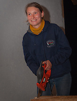 A girl from hungarian scout association is working nightshift in their foodhouse to get ready for the next day.