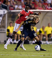 Danny Welbeck (19) of Manchester United is shielded from the ball by Toni Stahl (12) of Philadelphia Union during a friendly match at Lincoln Financial Field in Philadelphia, Pennsylvania.  Manchester United defeated Philadelphia Union, 1-0.