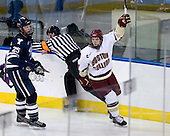 Cam Atkinson (BC - 13 skates past Ryan Donald (Yale - 25) to celebrate his goal. - The Boston College Eagles defeated the Yale University Bulldogs 9-7 in the Northeast Regional final on Sunday, March 28, 2010, at the DCU Center in Worcester, Massachusetts.