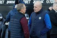 (L-R) Swansea City manager Steve Cooper speaks with Paul Cook manager of Wigan Athletic  during the Sky Bet Championship match between Swansea City and Wigan Athletic at the Liberty Stadium, Swansea, Wales, UK. Saturday 19 January 2020
