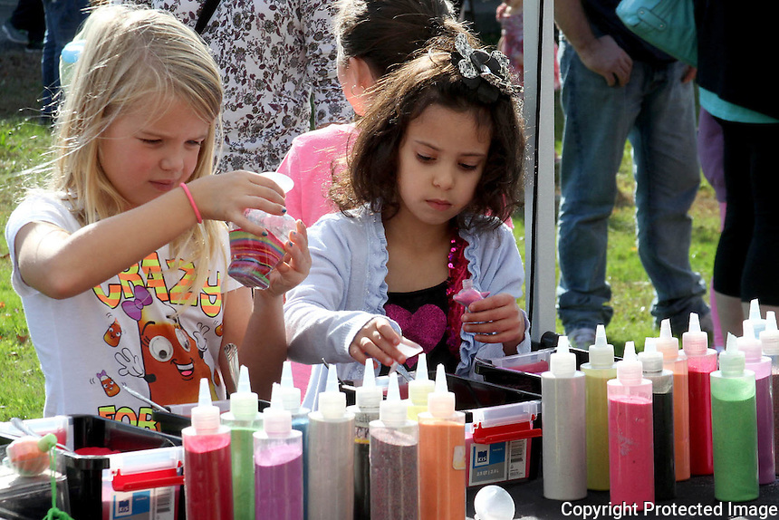 Molly Ryan and Isabel Jaramillo make sand art during the Thomas W. Hamilton Parent Council 7th annual Fall Festival Saturday October 25, 2014 at Thomas W. Hamilton Primary School in Weymouth..<br /> (Photo by Gary Wilcox)