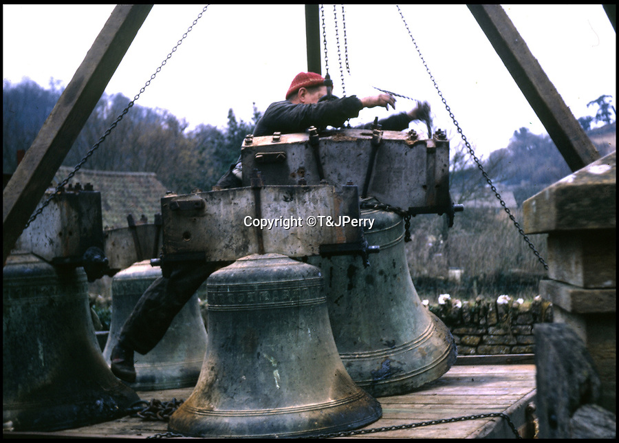 BNPS.co.uk (01202 558833)<br /> Pic: T&JPerry/BNPS<br /> <br /> Church Bells being fitted in the 1970's.<br /> <br /> The little changed Somerset village of Chiselborough whose residents have pieced together their history in photographs.<br /> <br /> A rural village's community has painstakingly put together its social history over the last 40 years, which is now going on display.<br /> <br /> Tony and June Perry first started collecting images of Chiselborough, in south Somerset, 40 years ago for the project which celebrates the village's people, traditions and buildings.<br /> <br /> Dozens of villagers have helped the couple compile 600 photos which are finally going to be shown in a new exhibition.<br /> <br /> The images, which date back to the 1860s, highlight many notable events in Chiselborough's history including the fire of 1890 which saw the pub burn down.<br /> <br /> Other photos show the silver jubilee party of 1935, a school fancy dress day in 1954 and the renovation of the village's 12th century church in 1971.<br /> <br /> Situated on the River Parrett, Chiselborough is five miles west of Yeovil and has a population of just 275 people.