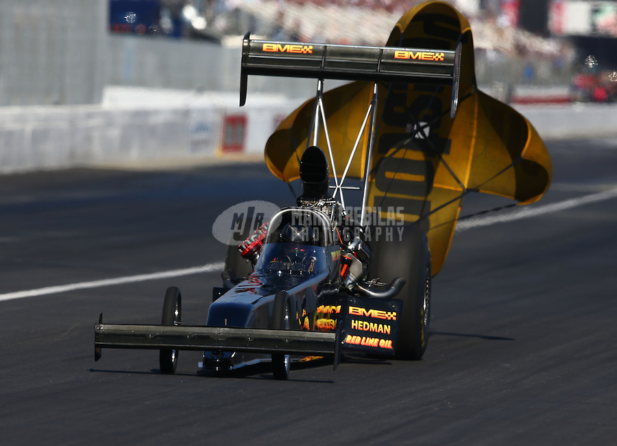 Feb 8, 2014; Pomona, CA, USA; NHRA top fuel dragster driver Troy Buff during qualifying for the Winternationals at Auto Club Raceway at Pomona. Mandatory Credit: Mark J. Rebilas-