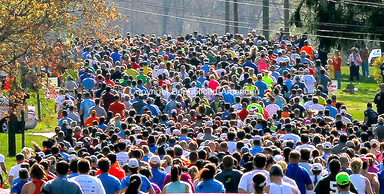 Cheshire, CT- 28 April 2013-042813CM03-  Scores of runners take off on Elmwood Drive at the start of the Cheshire Half Marathon in Cheshire Sunday morning.  3,000 runners took place in the event which also featured a 5k.  Christopher Massa Republican-American