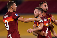 Jordan Veretout of AS Roma celebrates with Edin Dzeko and Bryan Cristante after scoring on penalty the goal of 2-1 during the Serie A football match between AS Roma and ACF Fiorentina at stadio Olimpico in Roma (Italy), July 26th, 2020. Play resumes behind closed doors following the outbreak of the coronavirus disease. <br /> Photo Antonietta Baldassarre / Insidefoto