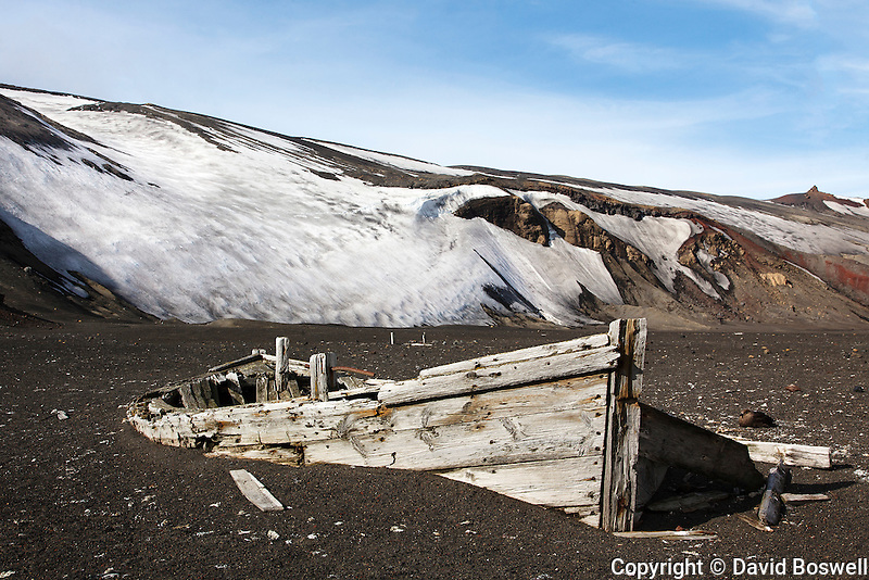 The remains of a water boat on the beach of Whalers Bay, Deception Island stands testament to the whaling history in the Antarctic region.  Water boats were used to bring freshwater from the land to the whaling ships anchored in the bay.