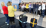 OXFORD CT. 11 March 2018-031219SV03-Students and staff turned out to say goodbye to Dorothy Potter, principal, Jack Fairhurst, 17, and Thomas Romeo, 17, as the leave for Abu Dhabi at Oxford High School in Oxford Tuesday. The two students are members of the schools Unified Sports team and will take part in a global youth summit at the Special Olympics. <br /> Steven Valenti Republican-American