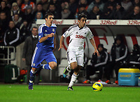 Pictured: Neil Taylor of Swansea (R) followed by of Chelsea (L). Tuesday, 31 January 2012<br />