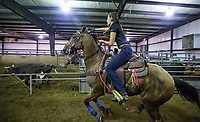 NWA Democrat-Gazette/BEN GOFF @NWABENGOFF<br /> Kaylee Sorrell of Crane, Mo. competes Thursday, Aug. 8, 2019, during the team roping event during Benton County Fair in Bentonville.