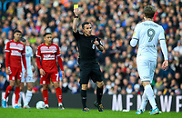 Referee Keith Stroud shows Leeds United's Patrick Bamford a yellow card<br /> <br /> Photographer Alex Dodd/CameraSport<br /> <br /> The EFL Sky Bet Championship - Leeds United v Middlesbrough - Saturday 30th November 2019 - Elland Road - Leeds<br /> <br /> World Copyright © 2019 CameraSport. All rights reserved. 43 Linden Ave. Countesthorpe. Leicester. England. LE8 5PG - Tel: +44 (0) 116 277 4147 - admin@camerasport.com - www.camerasport.com