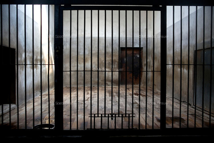 A small concrete and iron cage sits empty in the lion and tiger house at the zoo in Beijing, China.